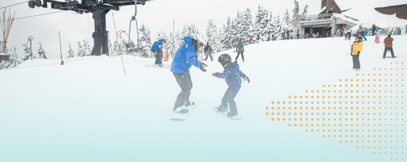 An older snowboarder holds out their hands to a young snowboarder who doesn't accept, concentrating on learning on their own.