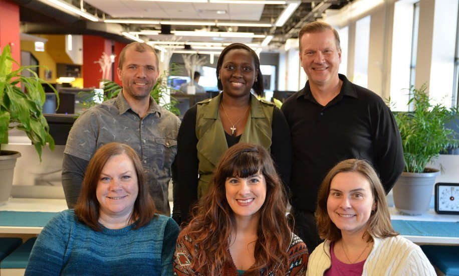 Six people from the Highland CRM team standing together in the Highland office in Chicago.