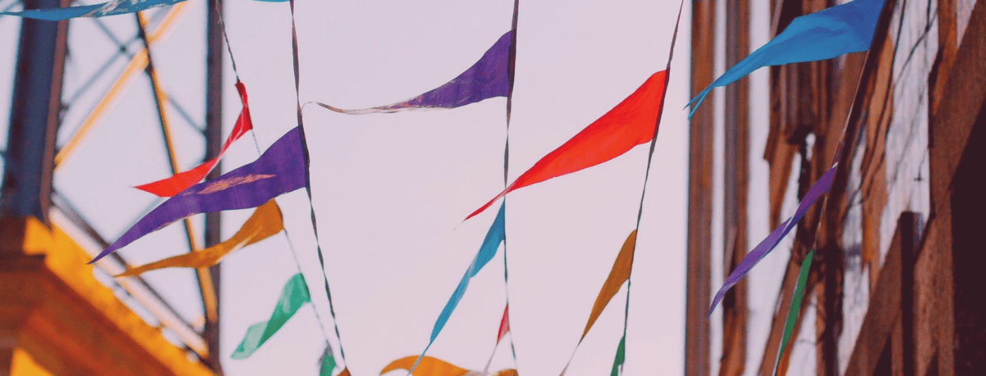 Colorful flags hanging between buildings, blowing in the wind