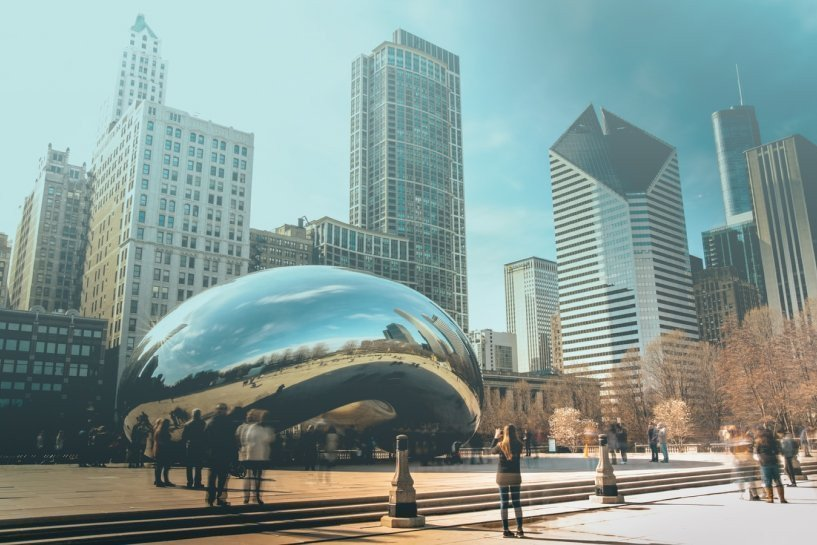The iconic Chicago bean with blurred people (exposure effect) standing around.